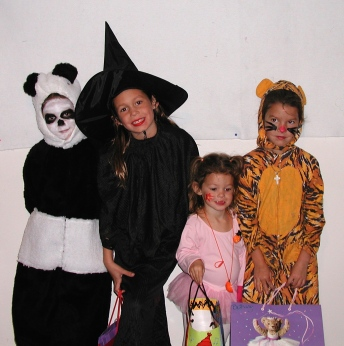My kids wearing costumes made by my mother.