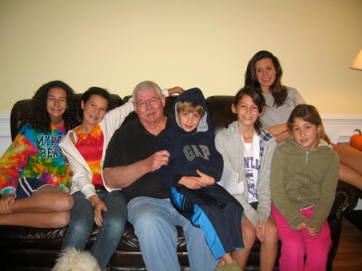 My dad hanging out with a several of his 13 grandchildren.