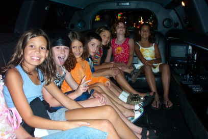 Neighborhood friends make great traveling companions when the dads are deployed. Here we are taking a limo ride in NYC!